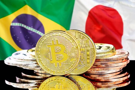 Concept for investors in cryptocurrency and Blockchain technology in the Brazil and Japan. Bitcoins on the background of the flag Brazil and Japan.