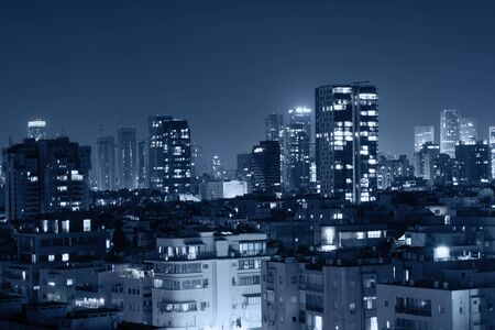 Photo pour Night view of the city life. Light of the buildings shining with cool blue tones. View of night scene of Tel Aviv, Israel. Blue tone city scape. - image libre de droit