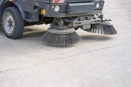 Photo pour Street sweeper machine working. Street cleaning machine. - image libre de droit