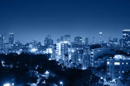 Photo pour Night view of the city life. Light of the buildings shining with cool blue tones. View of night scene of Tel Aviv, Israel. Blue tone city scape. Selective focus. - image libre de droit