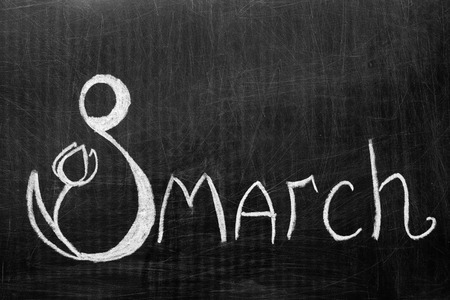 Photo pour The eighth of March written on the chalkboard . Figure eight with a flower. - image libre de droit