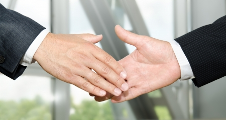 Male handshake isolated on business background の写真素材