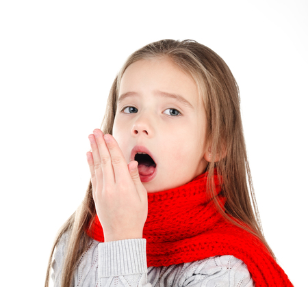 Sick little girl in red scarf coughing isolated on a white background