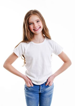 Photo for Portrait of adorable smiling little girl child preteen in jeans and white t-shirt isolated on a pink background - Royalty Free Image