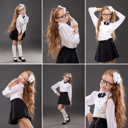 Pretty redhead schoolgirl on dark background. School, fashion, education concept