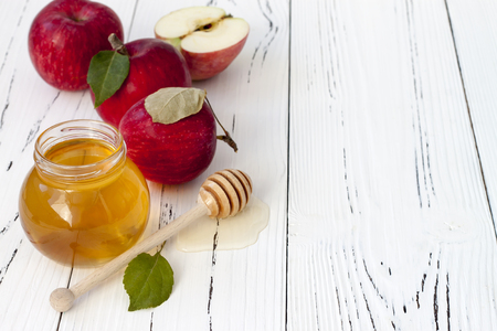 Apple and honey, traditional food of jewish New Year - Rosh Hashana. Copyspace backgroundの写真素材