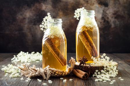 Homemade fermented cinnamon and ginger kombucha tea infused with elderflower. Healthy natural probiotic flavored drink