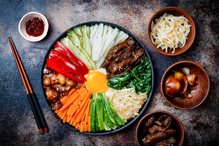 Foto de Bibimbap, traditional Korean dish, rice with vegetables and beef. Top view, overhead, flat lay - Imagen libre de derechos