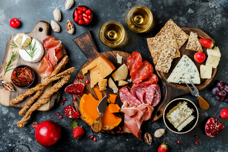 Photo pour Appetizers table with italian antipasti snacks and wine in glasses. - image libre de droit