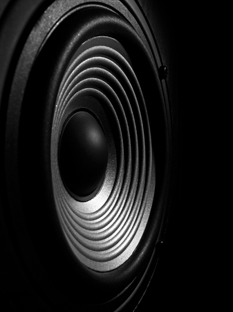 Photo pour black and white image of a membrane sound speaker isolated on a black background - image libre de droit