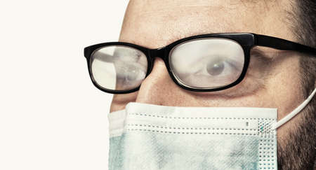 Photo for Fogged glasses. Discomfort experienced in wearing a face mask. - Royalty Free Image