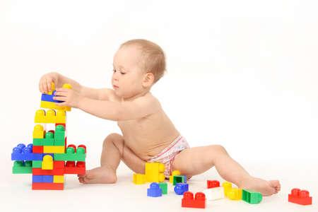 Photo pour The small child plays the designer a white background - image libre de droit