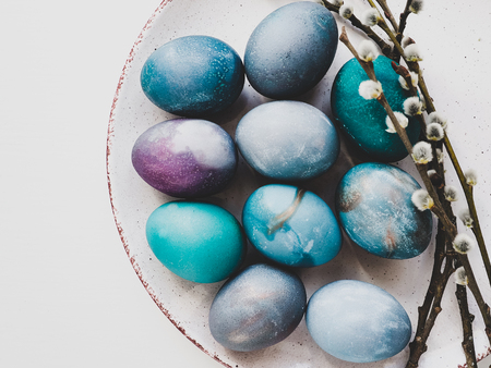 Photo for Easter eggs painted with bright colors on a white background. Top view, close-up, isolated. Happy Easter! Preparation for the holiday - Royalty Free Image