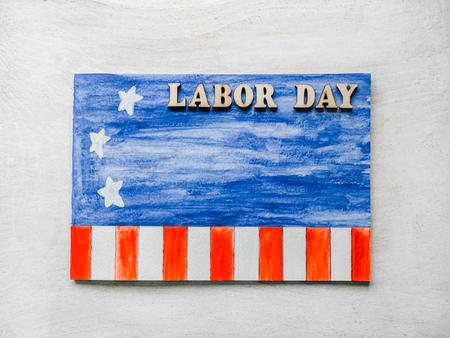 Photo for LABOR DAY. Notepad, American flag pattern and wooden letters of the alphabet on a white table. Close-up. Bright photo and space for your inscriptions. Congratulations to relatives, friends, colleagues - Royalty Free Image