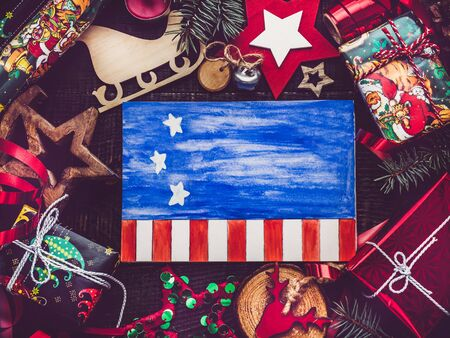 Foto per Merry Christmas and Happy New Year. Beautiful card with American flag pattern. View from above, close-up, flat lay. Congratulations to loved ones, family, relatives, friends and colleagues - Immagine Royalty Free