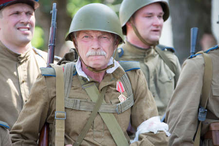 Belarus, Gomel. May 9, 2018. Victory Day. Historical reconstruction in 1945, capture of the Reichstag. Soldier of the Second World War. Warrior of the Red Army. Veteran of the Great Patriotic War in the form of