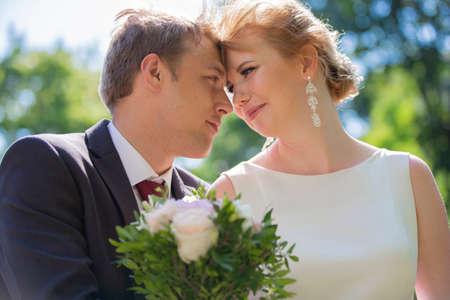 Foto für Beautiful bride and groom. Lovers. Newlyweds with a bouquet. - Lizenzfreies Bild