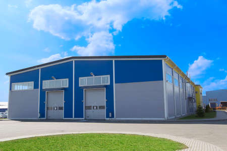 Photo for Industrial building against the blue sky. Factory - Royalty Free Image