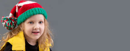 Photo for Funny little girl in a Christmas hat. Portrait of a cheerful and happy child. - Royalty Free Image