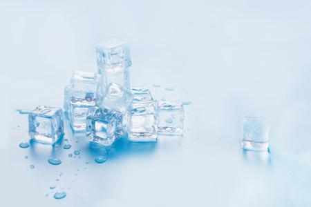 Photo pour Ice cubes isolated on blue background. Copy space. Close up. - image libre de droit