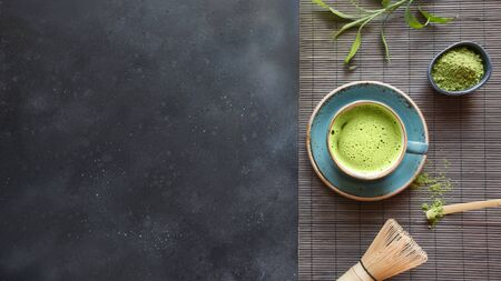 Photo for Still life with Japanese matcha green tea with accessories on black table. View from above. Space for text. - Royalty Free Image