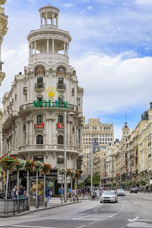 Madrid, Spain - June 5, 2017: Famous Edificio Grassy building with the Rolex sign, and beautiful buildings on Gran Via, main shopping street