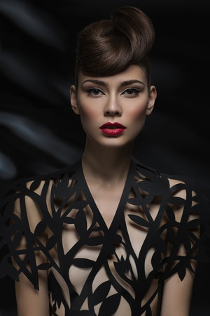 Sexy sensual woman with red lips and a fashionable blouse