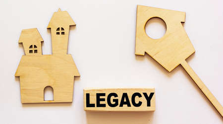 Photo pour LEGACY word about building blocks and homemade houses concept on white background - image libre de droit