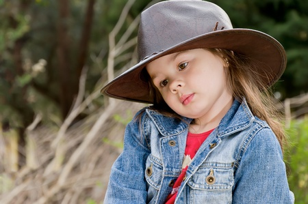 adorable little girl in cowboy hat