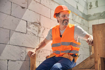 Photo pour Merry man in safety goggles looking away - image libre de droit