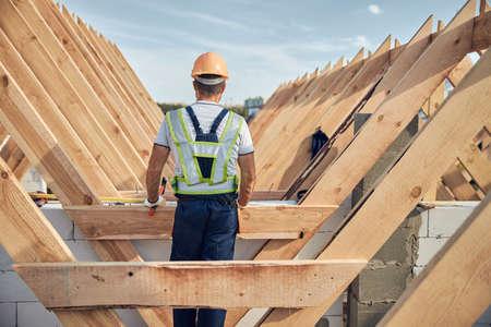 Photo pour Busy builder standing at a rooftop of a construction site - image libre de droit