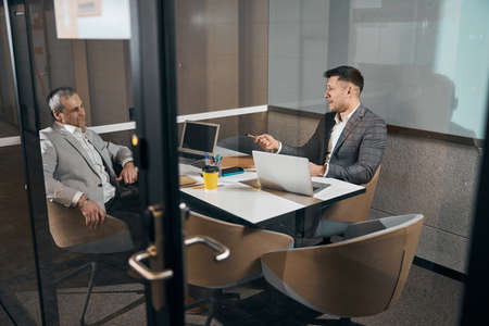 Photo for Joyful business partners working together in modern office - Royalty Free Image