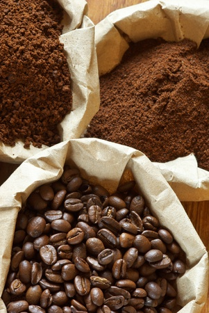 Close-up of assorted coffee in paper bags.