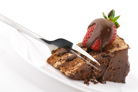Photo pour Slice of chocolate cake with strawberry and fork in white plate on white background. - image libre de droit