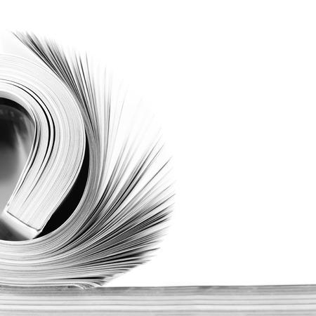 Rolled magazine on white background. B&W image.