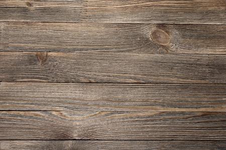 Foto de Natural knotted brown weathered wood plank texture background. - Imagen libre de derechos