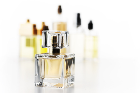 Various woman perfumes set on white background. Selective focus on front bottle