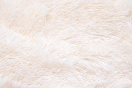 Photo pour Pale pink shaggy blanket texture as background. Fluffy fake textile fur. - image libre de droit