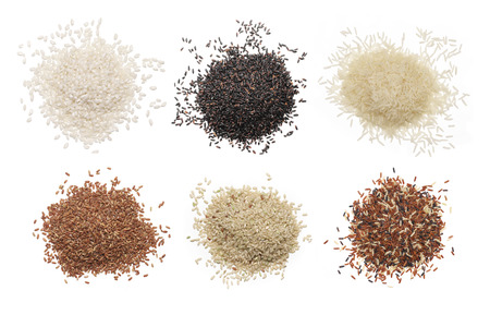 Foto de Set of various rice isolated on white background: glutinous, black, basmati, brown and red mixed rice. Top view. - Imagen libre de derechos