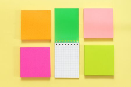 Photo pour Colorful stationery set on yellow paper background. Top view, flat lay. - image libre de droit