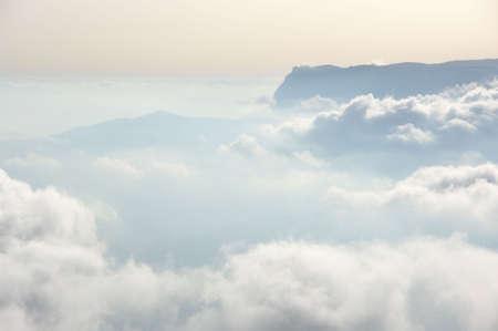 Photo pour Mountain peaks in fog. Over clouds landscape. - image libre de droit
