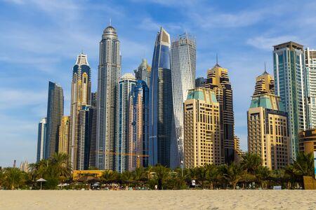 Photo pour Dubai, UAE - December 2, 2018: View of the high-rise buildings of Dubai from the beach. Dubai Marina district. - image libre de droit