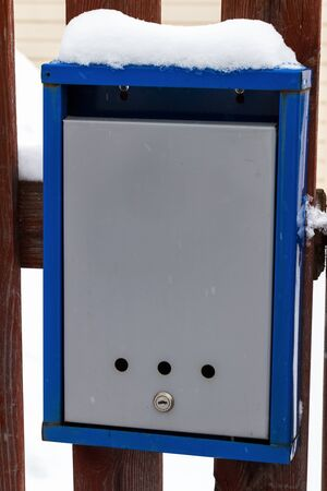 Photo for The rural mailbox on the fence is covered in snow. - Royalty Free Image