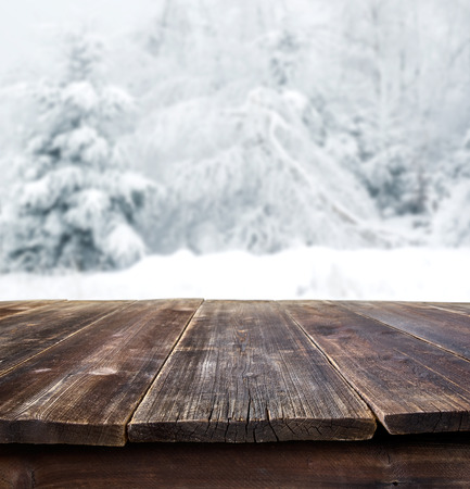 Photo for rustic table against winter landscape - Royalty Free Image