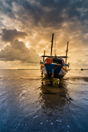 Fishing sea boat and Sunrise clouds before strom in Thailand blue  light toneの写真素材