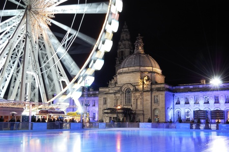 An empty Ice rink and winterwonderland Cardiff. City Hall in background.