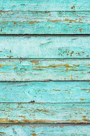 Photo pour The surface of an old light green, cracked wood plank as a texture. The boards are laid horizontally. Vertical image. - image libre de droit