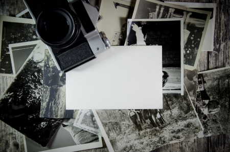 retro still, old photos on wooden table background.