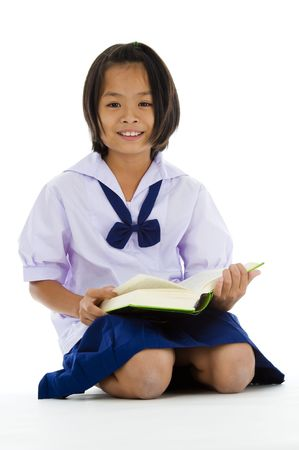 cute asian schoolgirl with book, isolated on white background