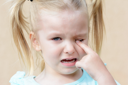 Crying baby. Hysterical girl with blond hair.